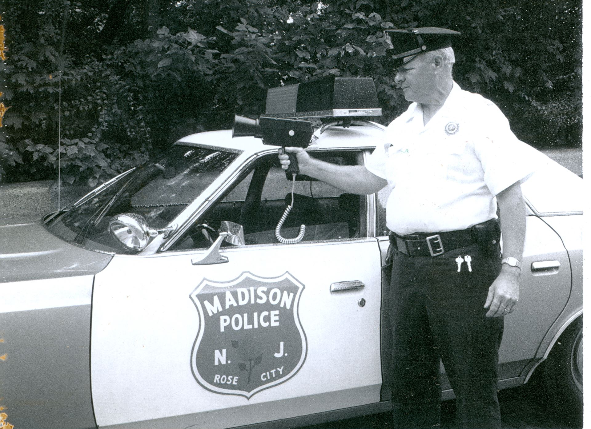 Black and White Traffic Officer and Patrol Car